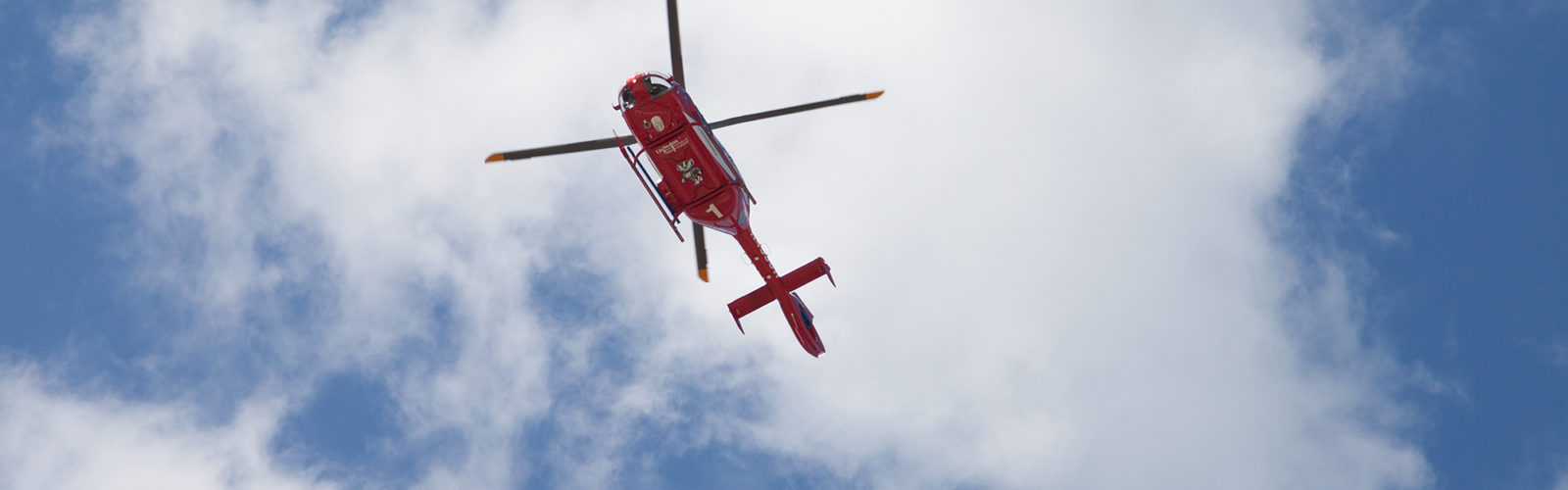 Shot from below, MedFlight in air, above viewer, hovers above University Hospital, UW-Madison, awaiting clearance to land