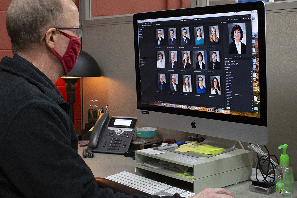 John Wingren hard at work reviewing portraits after recent photo shoots