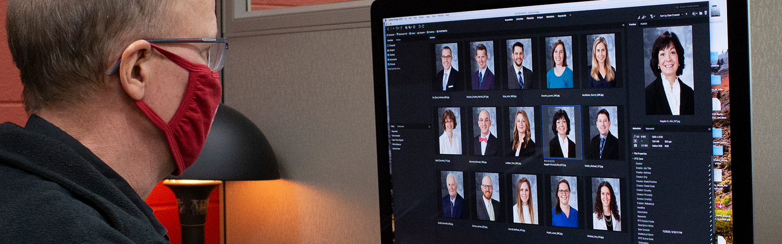 John Wingren at work in Media Solutions office Rm 1373, reviewign a recent Portraits photo shoot