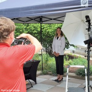Photo of Media Solutions photographers at work during White Coat Ceremony. Photo by Kari Schrage